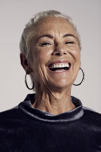 Portrait of cool mature woman laughing - gettyimageskorea
