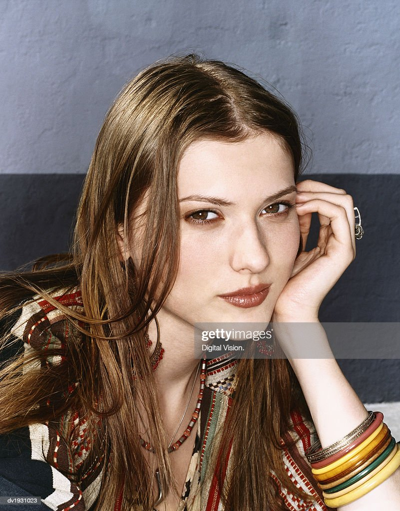 Portrait of Cool Twentysomething Woman Wearing Bangles : Stock Photo