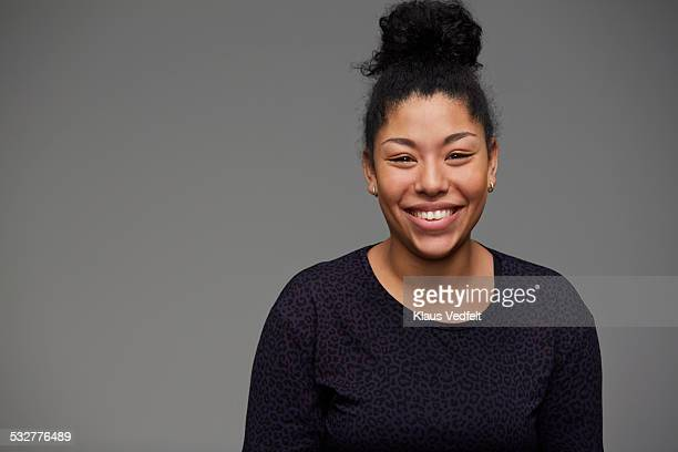 Portrait of cool woman laughing to camera