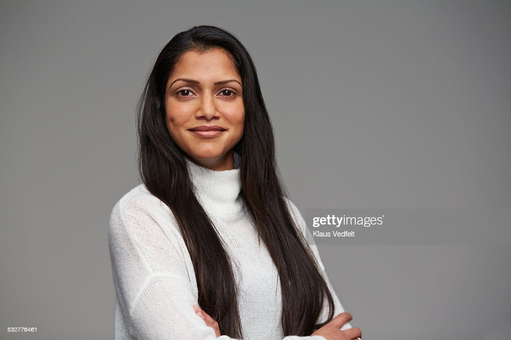 Portrait of cool woman with crossed arms : Stock-Foto