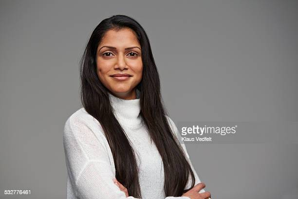 portrait of cool woman with crossed arms - indian woman stock photos and pictures