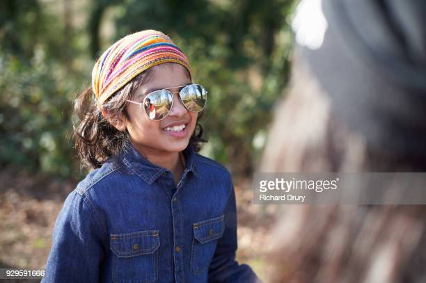 Portrait of cool young boy in countryside
