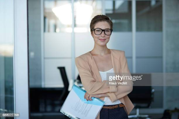 portrait of cool young business woman, in modern office - ビジネスウェア ストックフォトと画像
