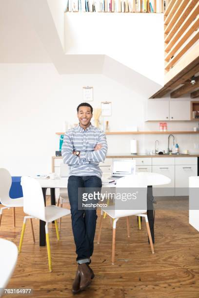 portrait of cool young businessman in office kitchen - heshphoto stock pictures, royalty-free photos & images