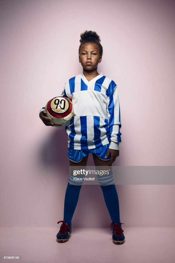 Portrait of cool young female football player : Stock Photo