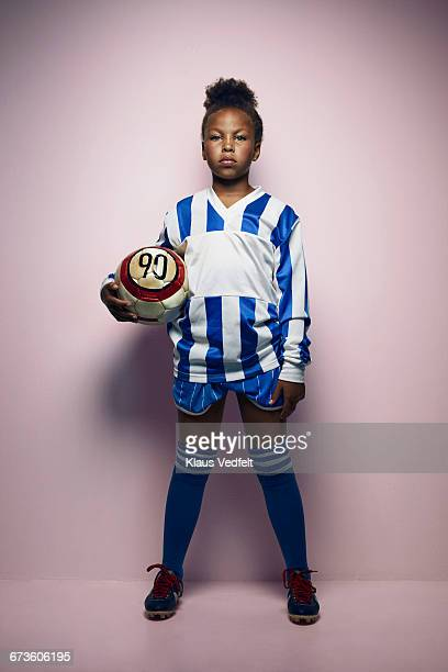 portrait of cool young female football player - fußballtrikot stock-fotos und bilder