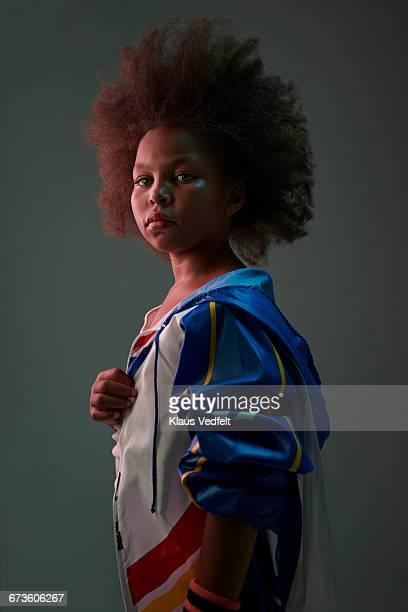 portrait of cool young girl wearing sports clothes - ein mädchen allein stock-fotos und bilder