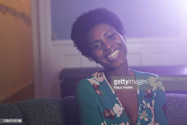 portrait of cool young woman laughing, at party - flat chested woman stock photos and pictures