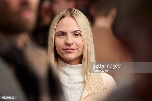 portrait of cool young woman smiling among crowd - gray eyes stock pictures, royalty-free photos & images