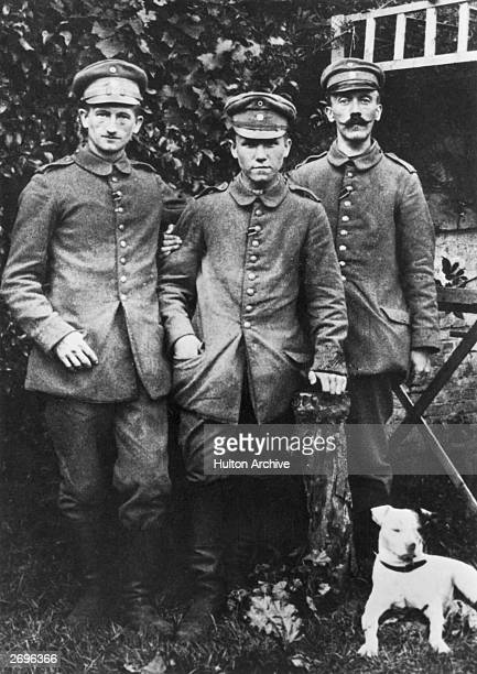 Portrait of Corporal Adolf Hitler right with two other soldiers and a dog during his stay in a military hospital WWI Pasewalk Pomerania