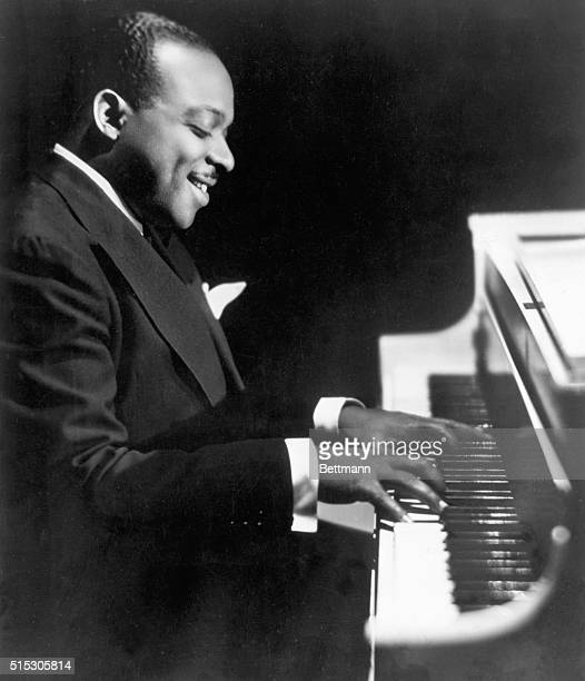 Portrait of Count Basie at the piano Photograph September 1943