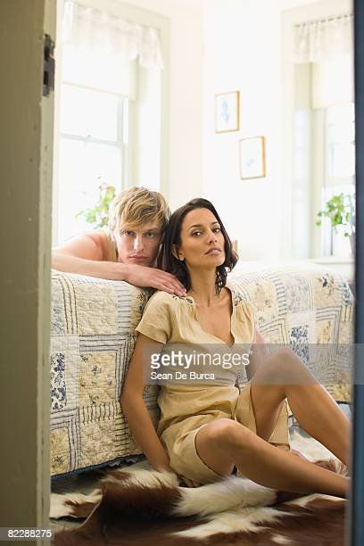 portrait of couple in bedroom - animal skin rug stock pictures, royalty-free photos & images