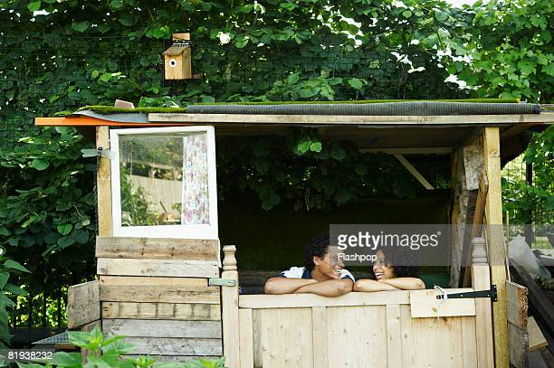 Portrait of couple in garden shed