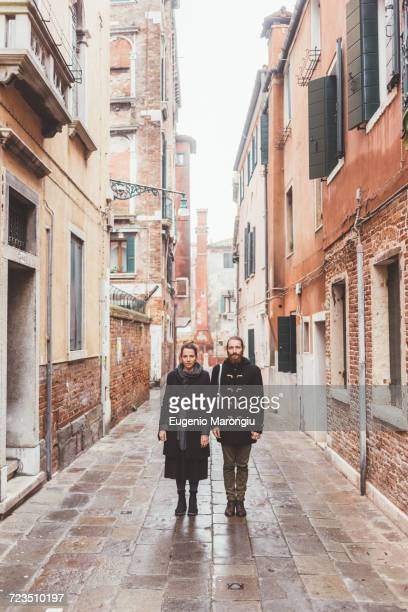 portrait of couple in street, venice, italy - long coat stock pictures, royalty-free photos & images