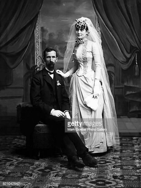 Portrait of couple in studio, late 1870s.