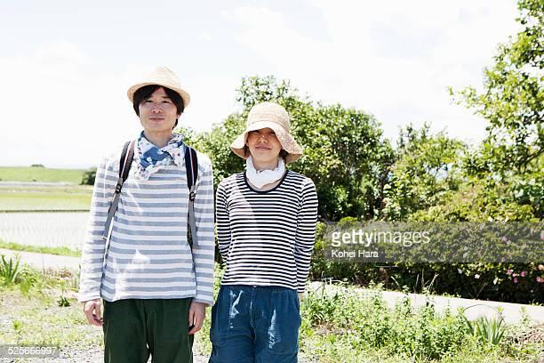 portrait of couple in the fields - 中年カップル ストックフォトと画像