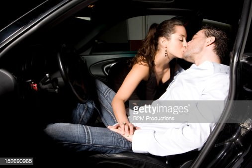 Portrait Of Couple Kissing In Car Stock Photo Getty Images - In car
