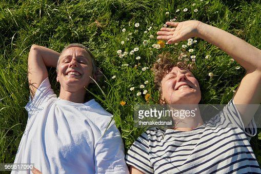 Portrait of couple lying on grass smiling