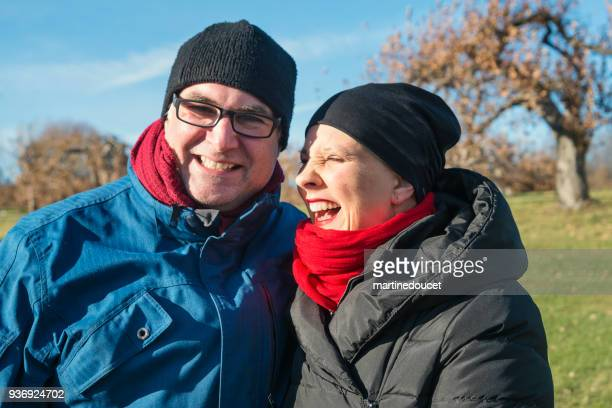 """portrait of couple outdoors in mid-season. - """"martine doucet"""" or martinedoucet stock pictures, royalty-free photos & images"""