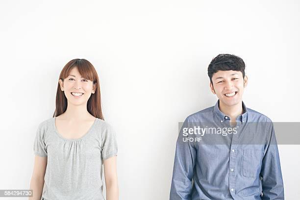 portrait of couple - 30代 ストックフォトと画像