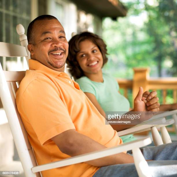 portrait of couple - rocking chair stock pictures, royalty-free photos & images