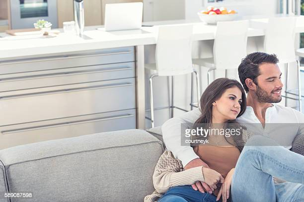 Portrait of couple relaxing on the sofa.