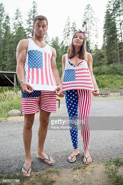 portrait of couple showing off american flag costume celebrating independence day, usa - female exhibitionist stock photos and pictures