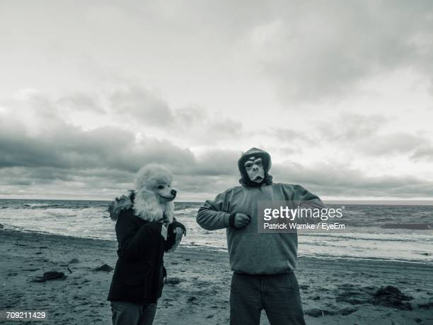 Portrait Of Couple Standing On Beach Against Sky