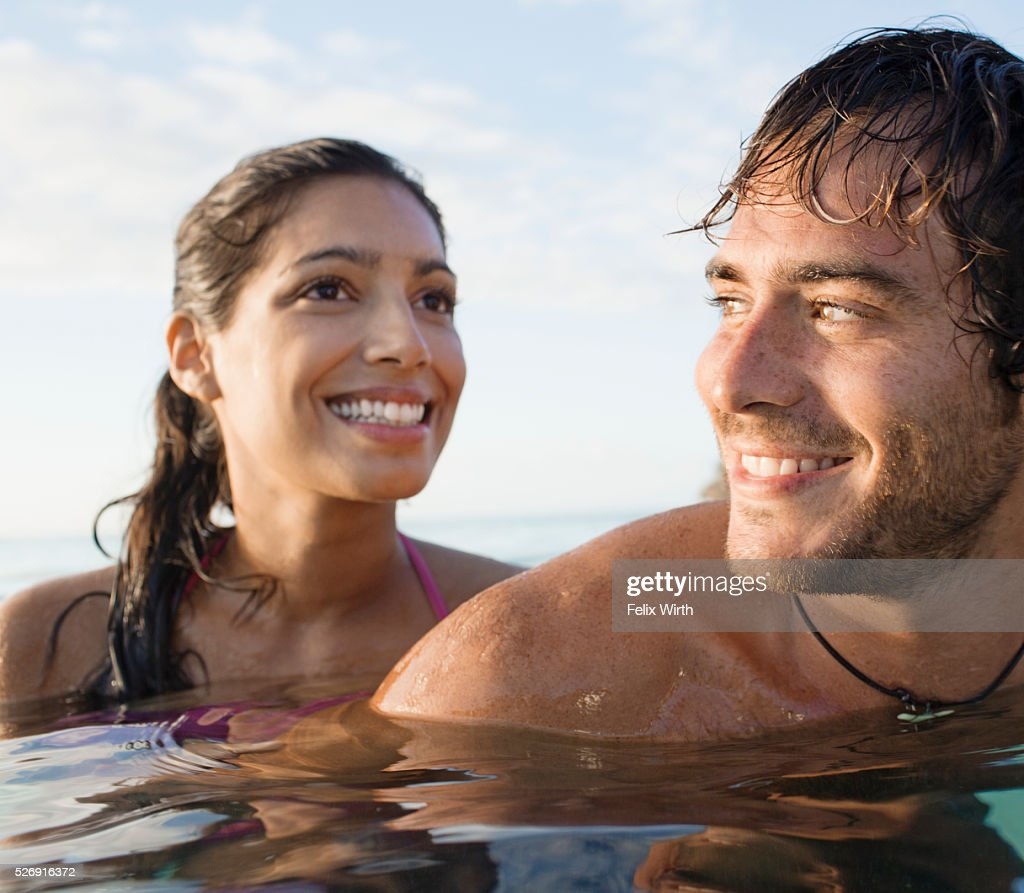 Portrait of couple swimming in sea : Stock Photo