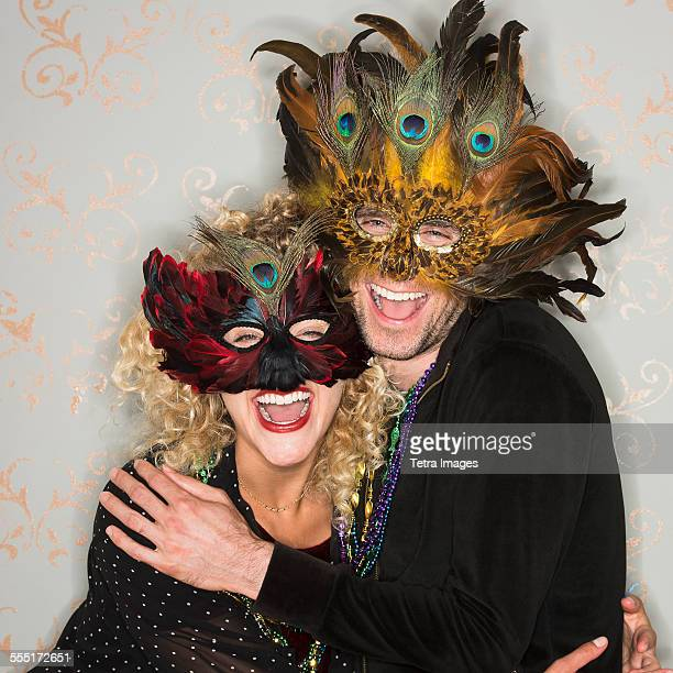 portrait of couple wearing holiday costumes - mardi gras party stock photos and pictures
