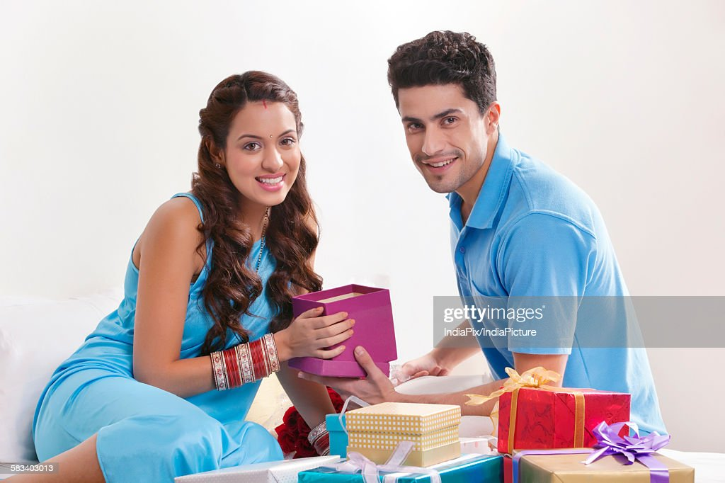 Portrait of couple with gift boxes : Stock Photo