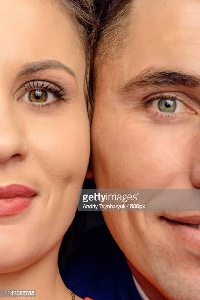portrait of couple with half of faces visible - side by side stock pictures, royalty-free photos & images