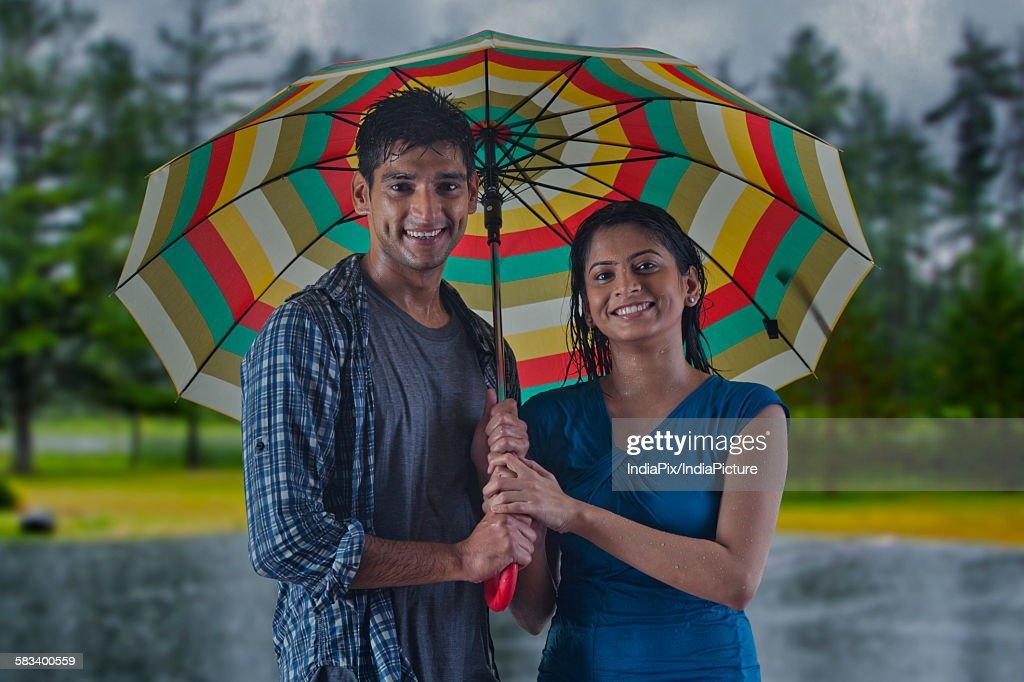 Portrait of couple with umbrella : Stock Photo