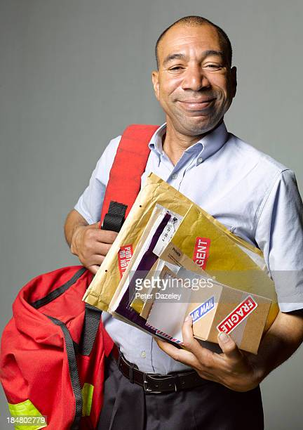 Portrait of courier/postman in sorting office