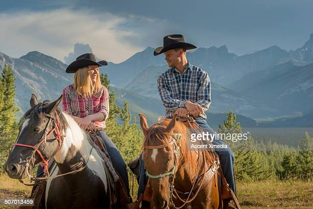 Portrait of cowboy & cowgirl in mountain setting