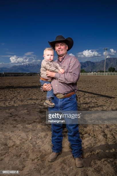 Portrait of Cowboy Holding Baby Son