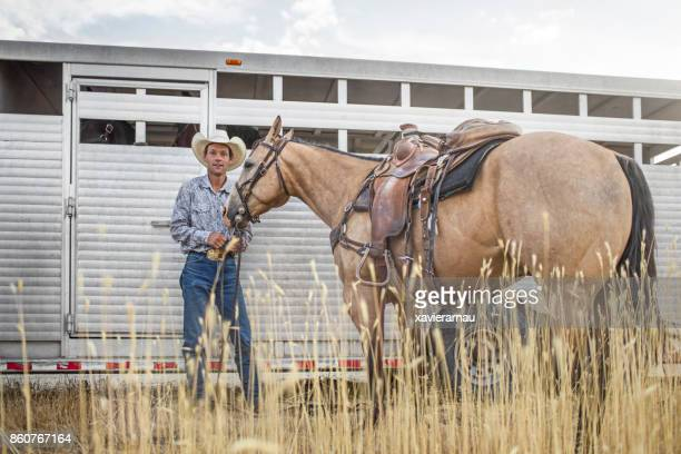 Portrait of cowboy preparing the horses for an event in Utah, USA