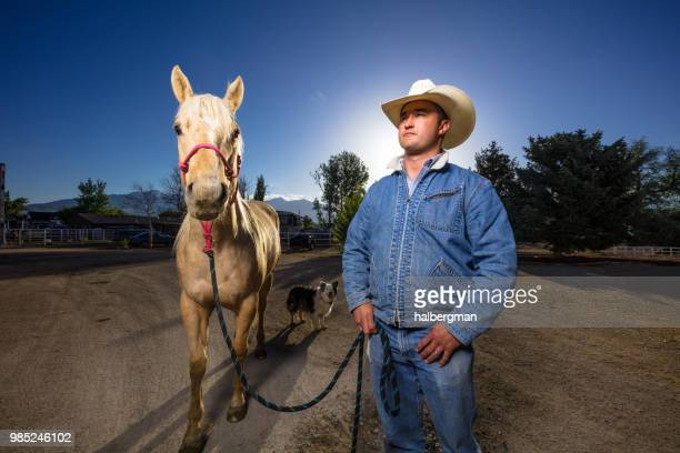 portrait of cowboy with horse and dog - double denim stock photos and pictures
