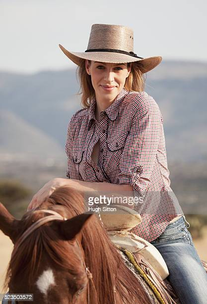 portrait of cowgirl riding horse - hugh sitton stock pictures, royalty-free photos & images