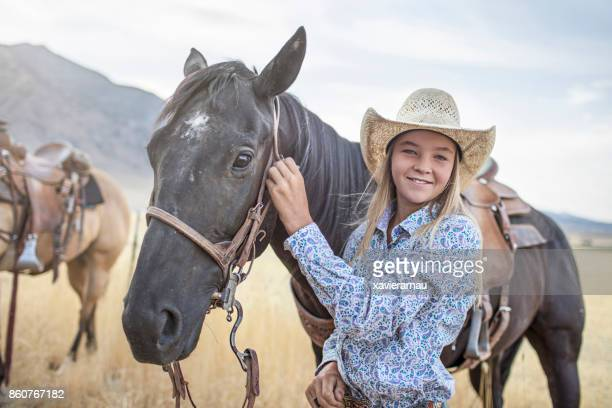 Portrait of cowgirl with her horse in Utah, USA