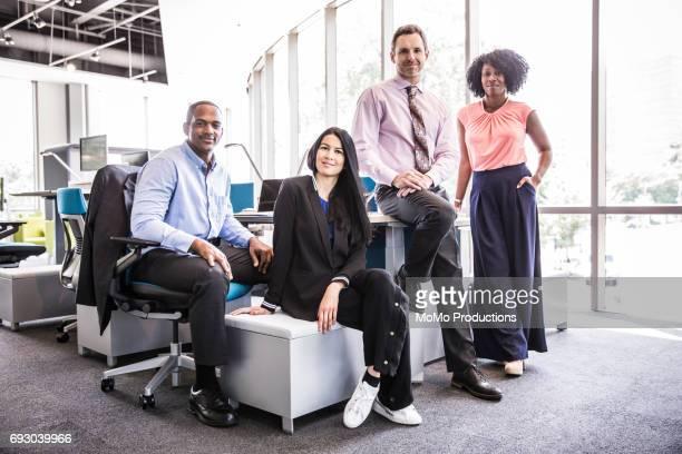 portrait of coworkers in modern business office - kleine personengruppe stock-fotos und bilder