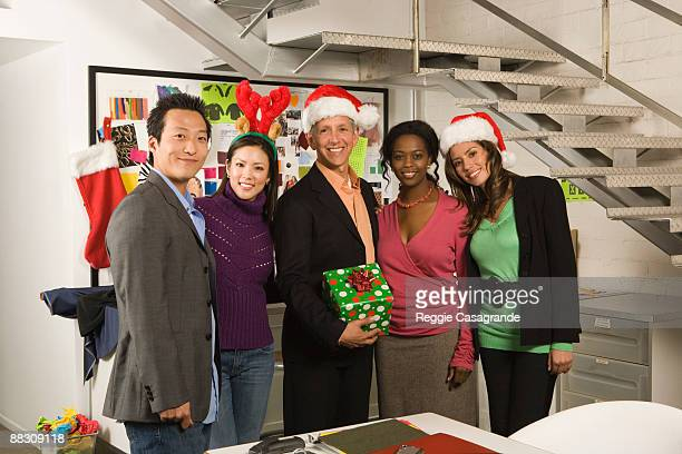 Portrait of co-workers in office at Christmas