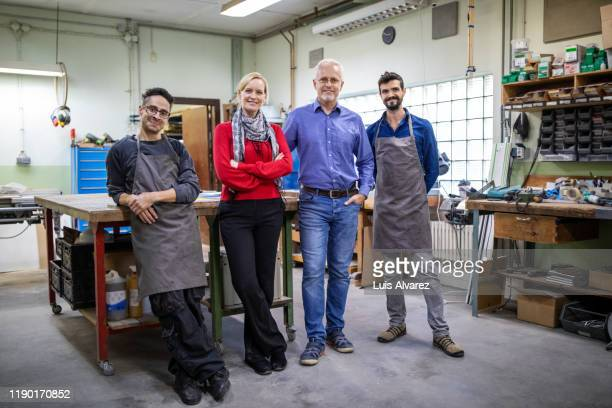 portrait of coworkers standing in workshop - neckwear stock pictures, royalty-free photos & images