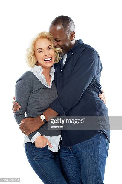 Portrait of cozy mature couple on white