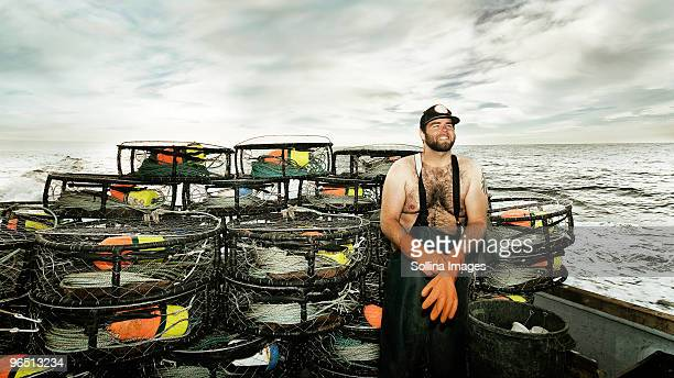 portrait of crab fisherman on the deck of the boat - crab pot stock photos and pictures