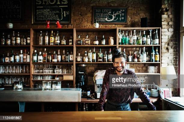portrait of craft beer bartender - bar stock pictures, royalty-free photos & images