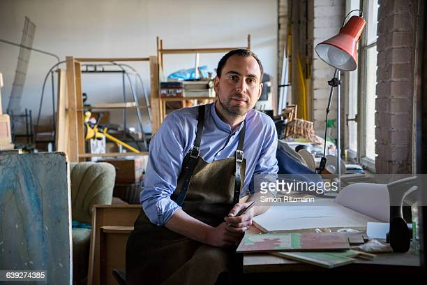 portrait of craftsman in atelier - rolled up sleeves stock photos and pictures