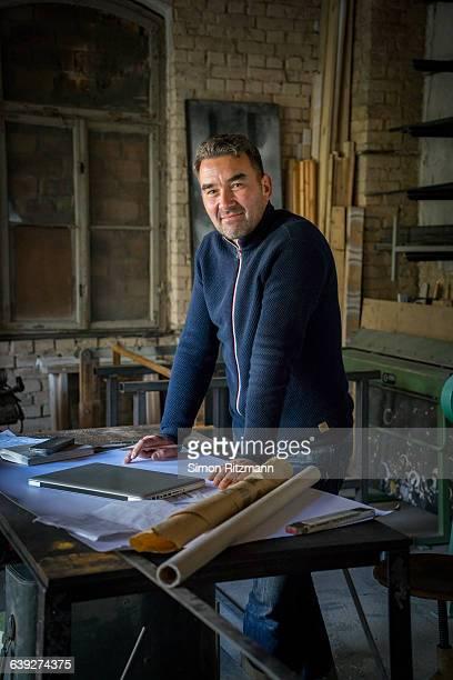 Portrait of craftsman in workshop