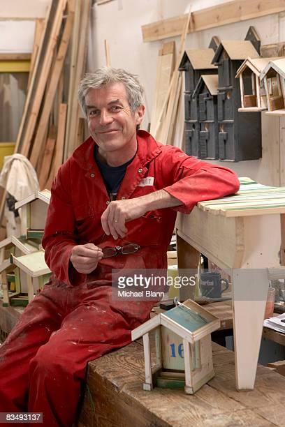 portrait of craftsman smiling in workshop