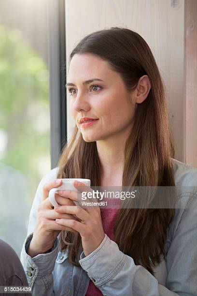 Portrait of creative business woman having coffee break